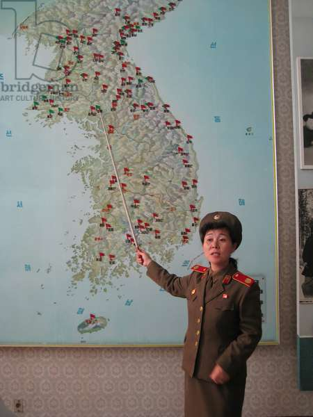 North Korean guide pointing to a map of the Korean Peninsular, 2008