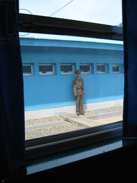 North Korean soldier guarding hut in the Joint Security Area of the Korean Demilitarised Zone, 2008 (photo)