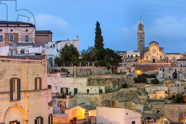 View of the stones of Matera with the Cathedral in the background, Matera, Italy (photo)