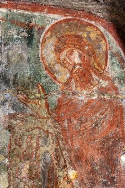 Castellaneta, Taranto, Puglia, Italy, The Rock Church of the Padreterno in the ravine of Coriglione. Fresco depicting St. John (photo)