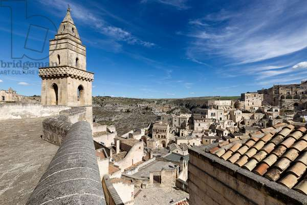 Bell tower of the Church of San Pietro Barisano and view of the stones, Matera, Italy (photo)