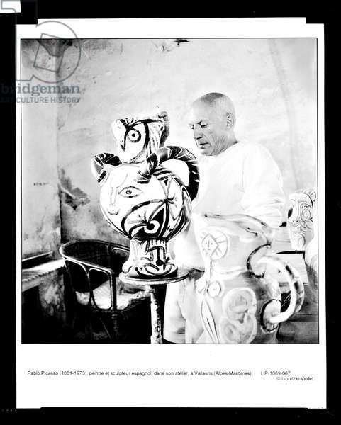 Pablo Picasso (1881-1973) in his studio at Vallauris, 1950s (b/w photo)