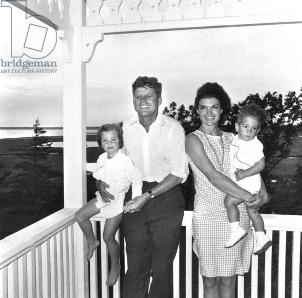 John F. Kennedy with his wife, Jackie, and their two children, January 1962 (b/w photo)