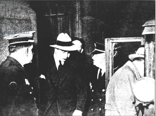 Al Capone (1899-1947) arrested and driven to prison in Philadelphia on 17th May 1929 (b/w photo)