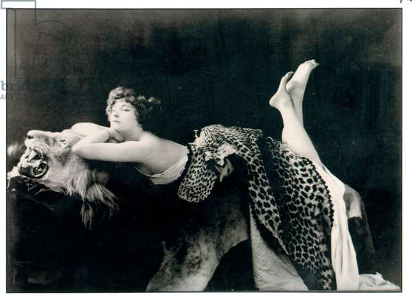 Colette (1873-1954) posing on a lion's skin, draped in a panther's skin, 1909 (b/w photo)