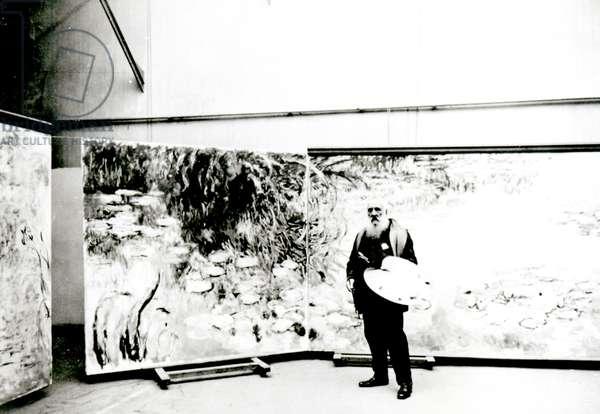 Claude Monet (1840-1926) before his Waterlilies in his Studio (b&w photo)