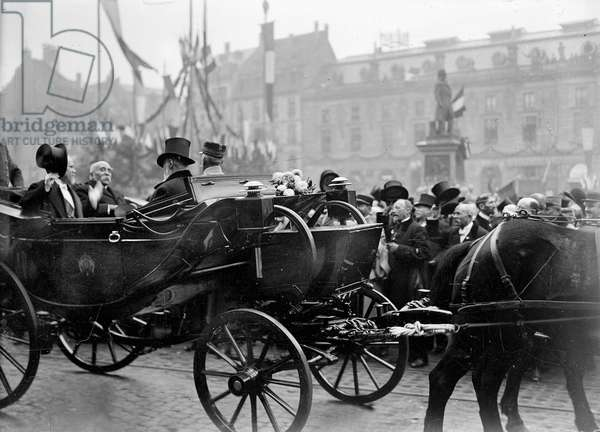 The Crowd hailing the arrival of President Raymond Poincaré and Georges Clemenceau, President of the Council, during an official Government visit to Strasbourg, 8th December 1918 (b/w photo)