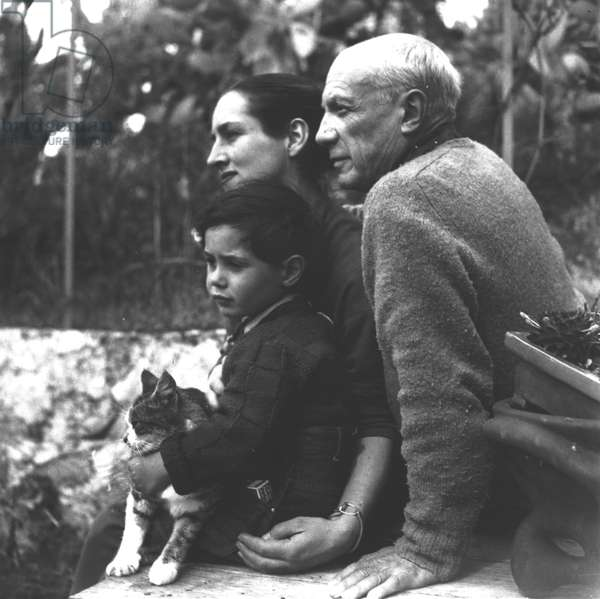 Pablo Picasso (1881-1973) with Francoise Gilot (b.1922) and their son Claude (b.1947), c.1952 (b/w photo)