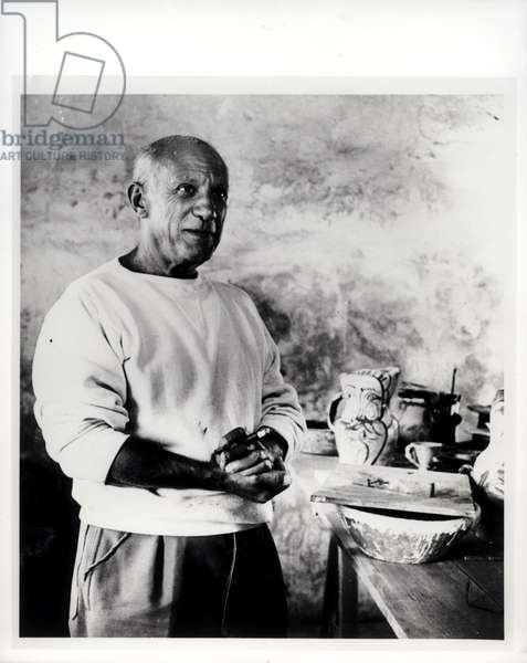 Pablo Picasso (1881-1973) in his studio at Vallauris, 1950s (b/w photo)