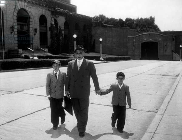 Michael, 10 years old (left) and Robert Rosenberg, 6 (right) with lawyer Emanuel Bloch at Sing Sing prison for probably their last visit to their parents, Julius and Ethel Rosenberg, Ossining, sentenced to death for State of New York, United States of America June 16, 1953 (b/w photo)