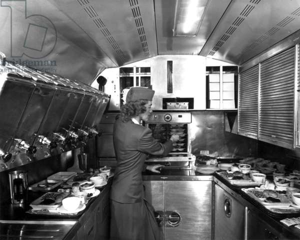 Stewardess preparing meal for passengers of plane, 1948