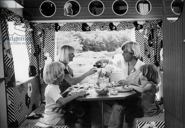In a caravan a family is having their dinner