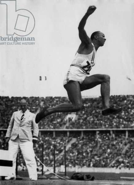 Jesse Owens, the American athlete, in action at the Olympic Games of Berlin. August 4, 1936.