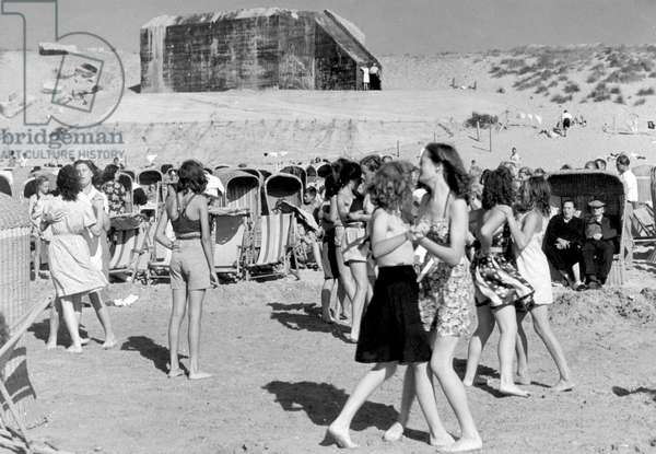 Dancing on the beach of Zandvoort where the remains of a bunker can be seen in the dunes, The Netherlands, 1947.