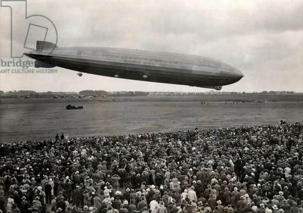 The German airship LZ 129 Graf Zeppelin above airfield Waalhaven near Rotterdam, The Netherlands, 18 June 1932 (b/w photo)