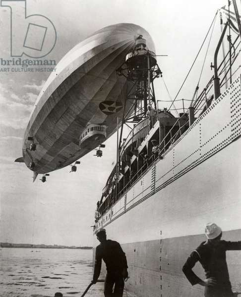 The American airship Los Angeles at the mooring mast on the USS Patoka 23 July 1931 (b/w photo)