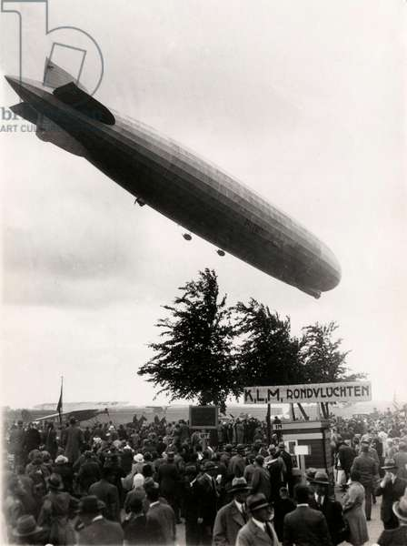 The German airship Graf Zeppelin above airfield Waalhaven near Rotterdam where it landed 18 June 1932 in sight of hundreds of thousands paying visitors, The Netherlands, 1932 (b/w photo)