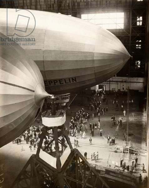 The American airship LZ 126 Los Angeles next to its sister ship LZ 127 Graf Zeppelin in the huge hangar of marine air base Lakehurst, 5 August 1929 (b/w photo)