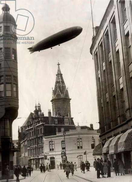 The German airship Graf Zeppelin above the Sint Jacobs tower in the Hague during Hollandfahrt, The Netherlands, 13 October 1929 (b/w photo)