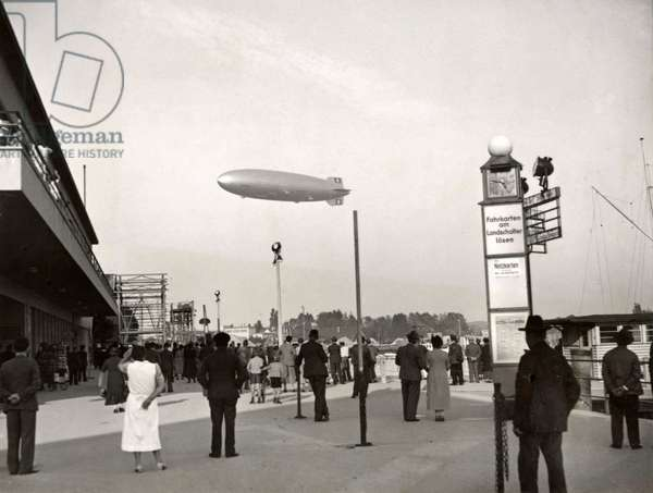 The last big German airship LZ 130 Graf Zeppelin for the first time above its place of birth Friedrichshafen, Germany, 14 September 1938 (b/w photo)