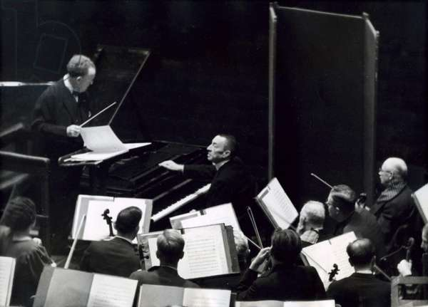 The famous Russian pianist and composer of classical music Sergei Rachmaninoff behind the grand piano during a rehearsal of the Concertgebouw Orchestra led by conductor prof. Dr. Willem Mengelberg (1871-1951), Amsterdam, 7 October 1938 (b/w photo)