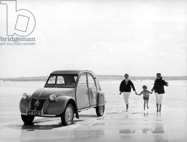 Cars: a Citroen 2CV (Deux Chevaux) on the beach seventies Location unknown