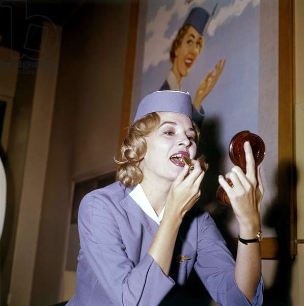 American flight attendant (Pan-American Airways) Elena Mandzik holding a mirror and applies lipstick, the Netherlands, 1961