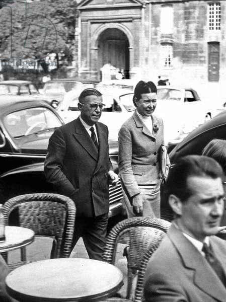 French writers Simone de Beauvoir and Jean Paul Sartre in Saint Germain des Pres, Paris, c.1955 (b/w photo)