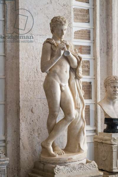 Ancient marble statue of young satyr with flute (marble)
