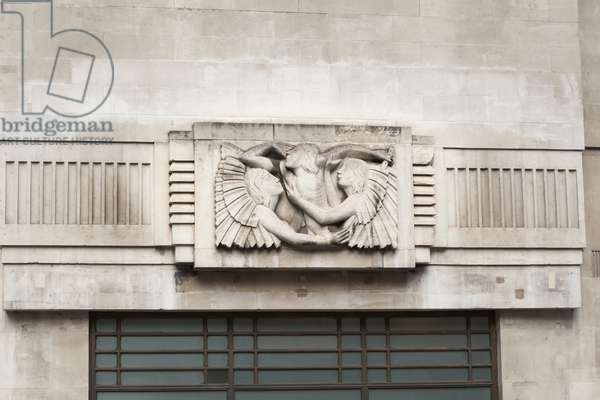 Eric Gill relief sculpture on the outside of BBC Broadcasting House in Portland Place, London, UK