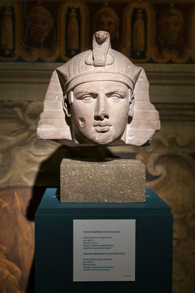 Head of Antinous in Egyptian style, 130-138 AD (red quartzite)