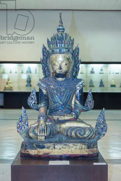 Image of crowned Buddha in Bhumispara mudra, 19th century AD (wood, gilt and inlaid with coloured glass)