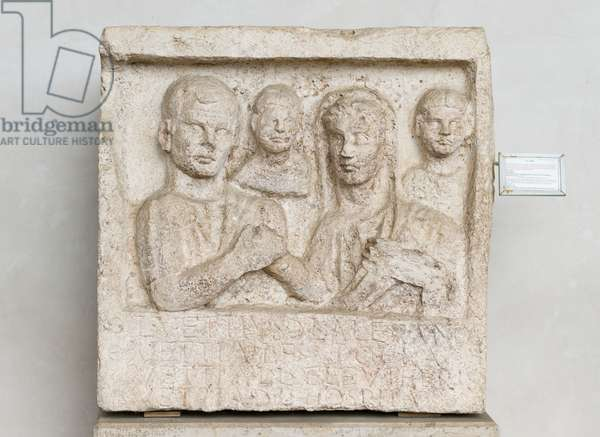 Funerary relief made by Vettia Hospita for her husband Lucius Vettius Alexander and her daughter Vettia Polla, depicting Vettius and his wife in the act of the dextrarum iunctio with two smaller busts behind, Augustian age, travertine marble, National Roman Museum at the Baths of Diocletian, Rome, Italy