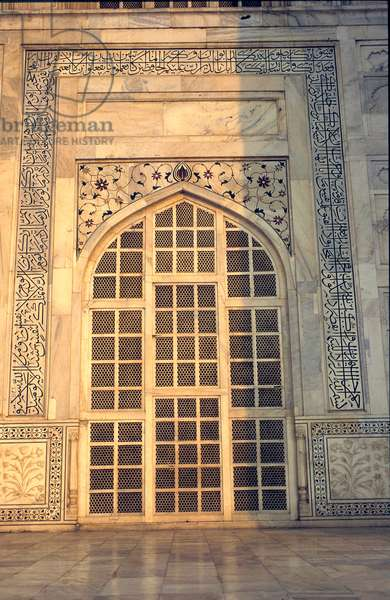 Taj Mahal, Agra. Window in mausoleum showing pierced marble screening and inlay work. India.