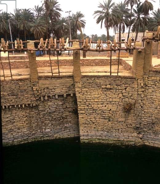 Saudi Arabia. Restored Haddaj Well. 550 BC. water pulled by camels, Tayma.