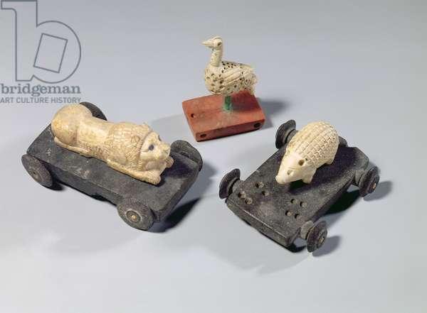 Children's toys: a hedgehog, a lion and a dove, Susa, Iran, Elamite Period, c.1150 BC (limestone and bitumen)