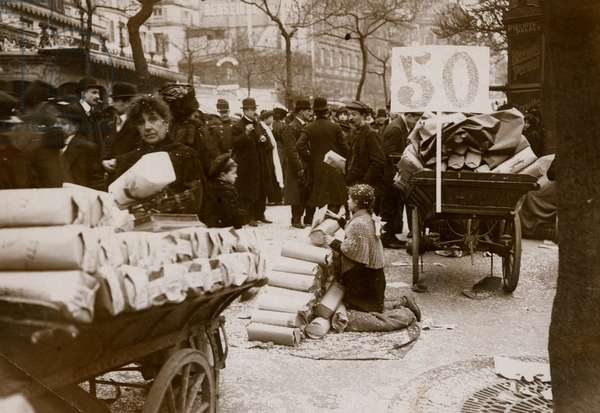 Selling confetti during Mardi Gras, Paris, 1910 (b/w photo)