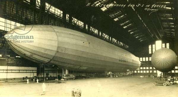 USS Shenandoah and J-1 in hangar, 1922 (sepia photo)