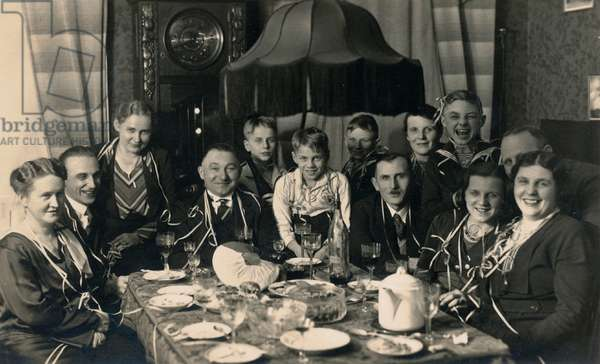 A family celebrating Christmas, Berlin, 1929 (b/w photo)