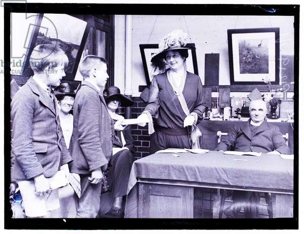 Mrs Stanley Baldwin presenting prizes to schoolchildren, 24th July 1923 (b/w photo)