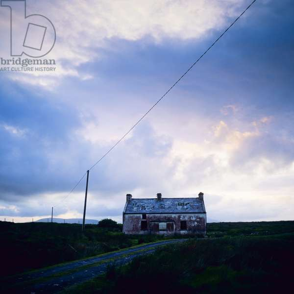 View of a derelict cottage at dusk, Achill Island, County Mayo, Ireland (photo)