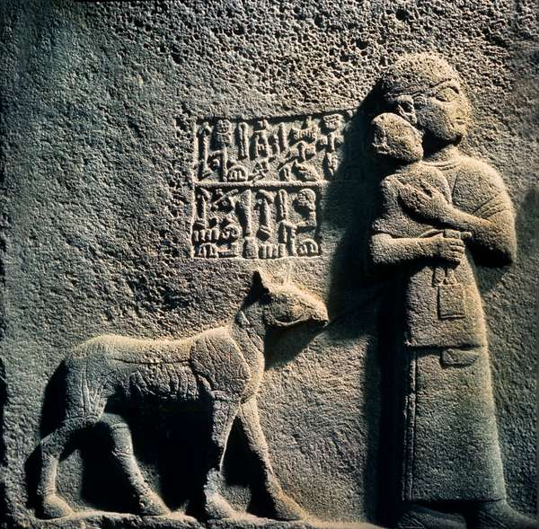 Relief of Queen Tawarisas, wife of King Araras, with youngest child and goat, from Carchemish (stone)