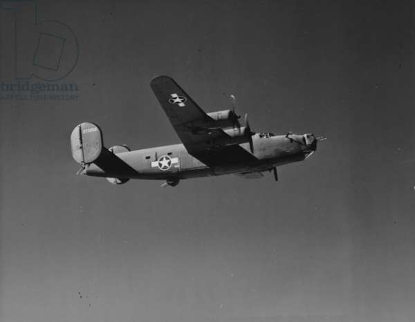 Image Of A WWII U.S. Military Aircraft In Flight Taken From The Side And Below
