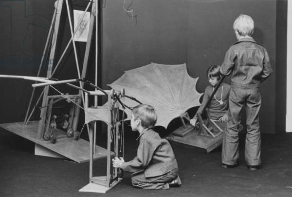 Children Interacting With A Display Featuring Flying Machines Designed By Leonardo da Vinci