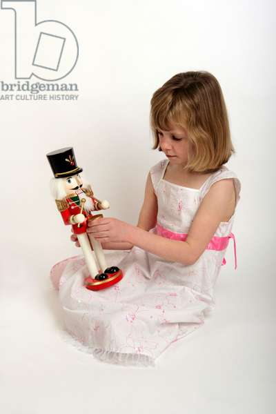 Nutcracker toy being held by a child
