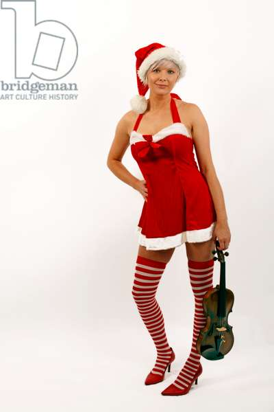 Young woman in a Miss Santa outfit holding an Violin.