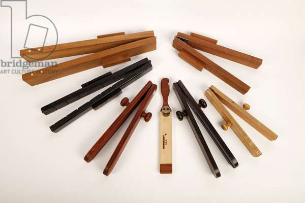 A collection of wooden whips, including two-handed and one-handed whips. (photo)