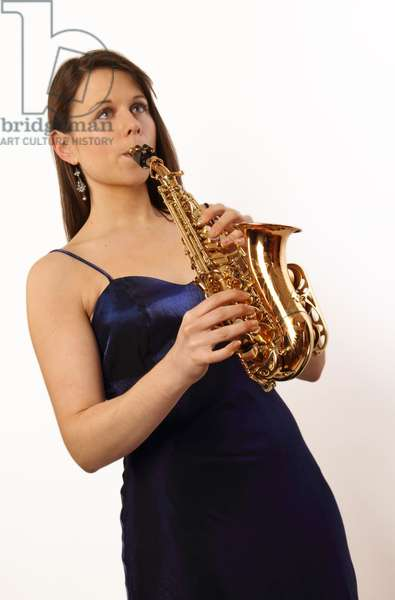 Young woman holding a soprano saxophone
