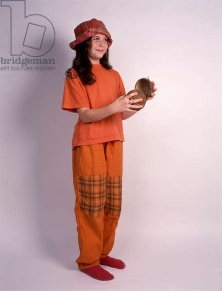 Primary school girl playing coconut shells