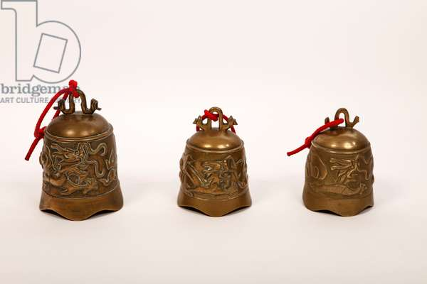 Set of three graded Temple Bells with Dragon motif cast in the bell.